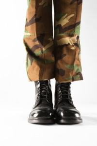 Military boots with camouflage pants