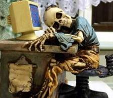 Skeleton waiting at a computer