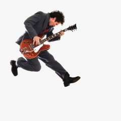 Musician with Guitar Jumping into Air